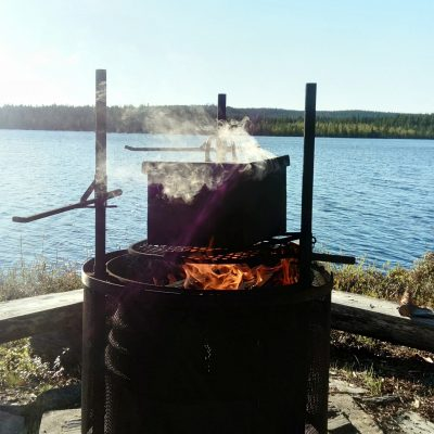 Smoking fish by the lakeside fire